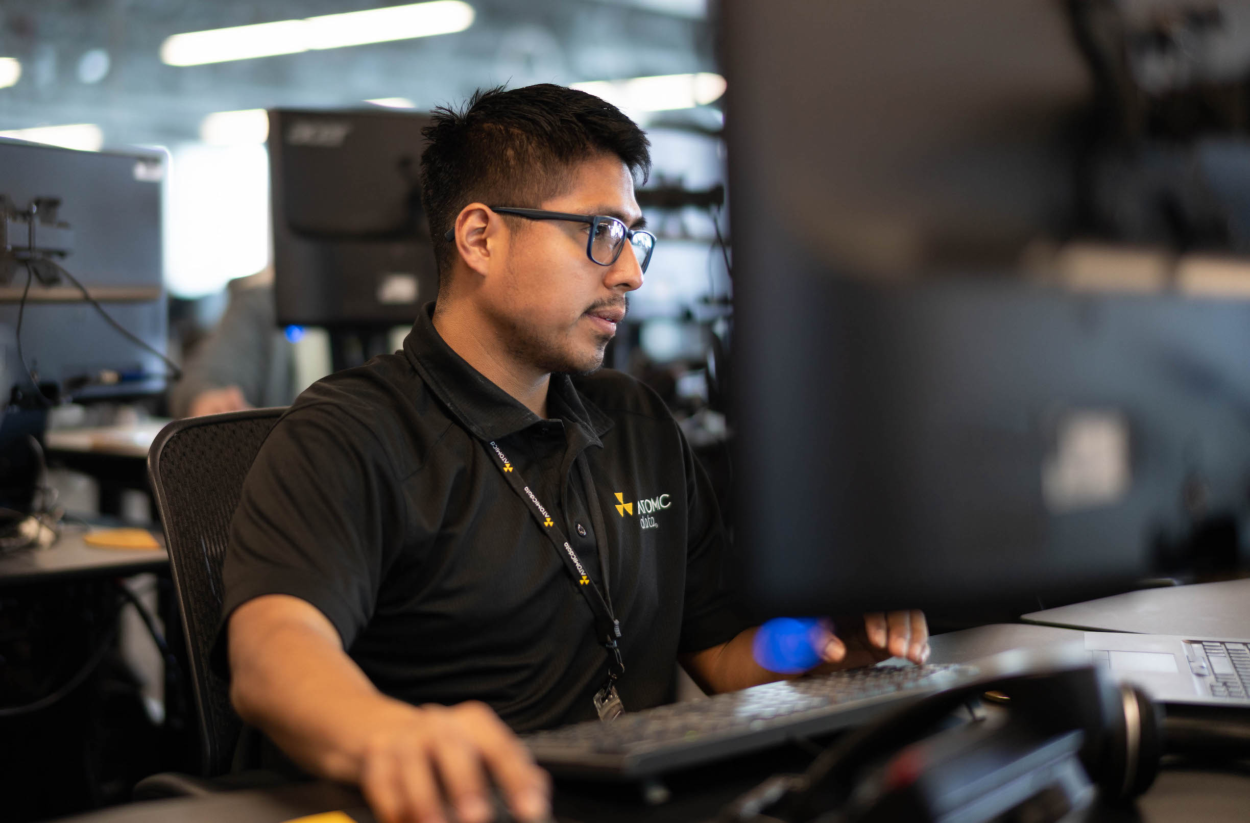 Atomic Data Technician on Computer